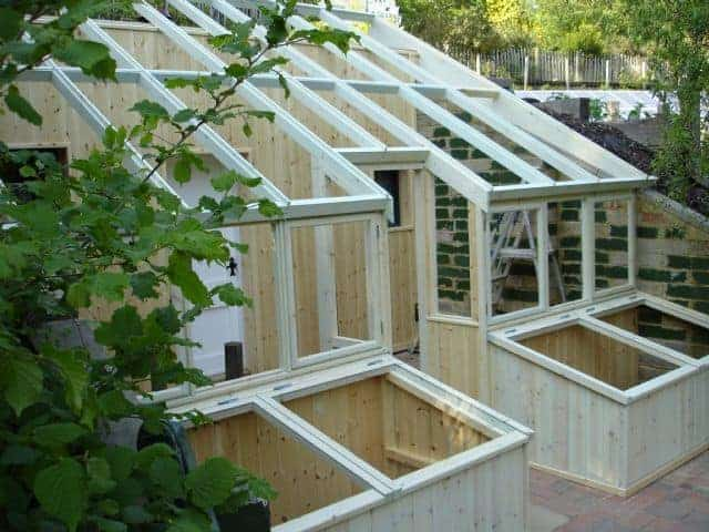 Building lean to greenhouses solariums family food garden for House plans with greenhouse attached