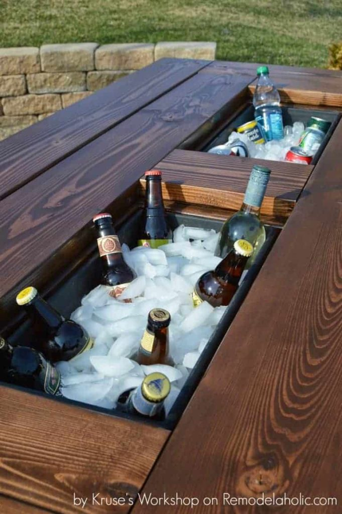 DIY backyard table with drinks in the middle