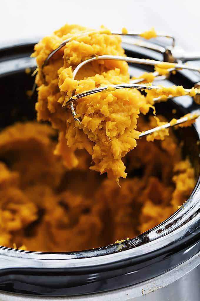 Mashed sweet potatoes in a slow cooker #crockpot #sidedishes #crockpotholidays #slowcooker #slowcookersidedishes #thanksgiving #christmasdinner #slowcookerchristmas #slowcookerthanksgiving #crockpotrecipes