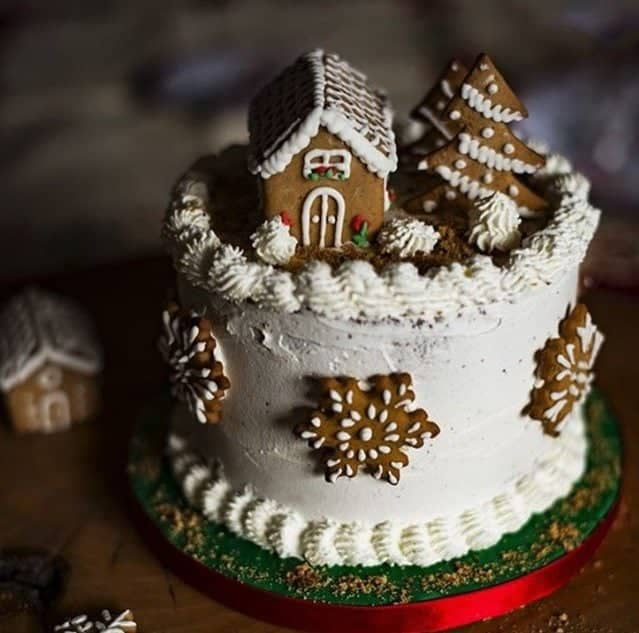 Mini gingerbread house on top of a cake