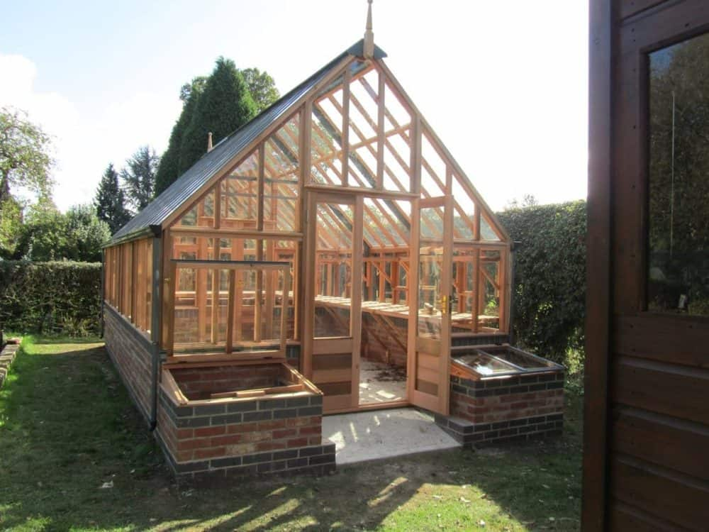 Wooden and brick greenhouse with cold frames #greenhouse